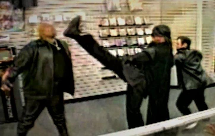 The Black Ninja lands a kick on his enemy