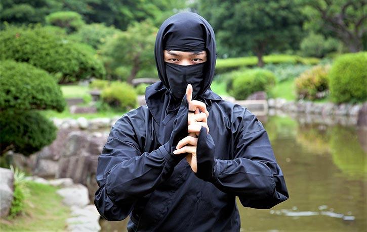 Ninja in Kuji-kiri (hand power symbol) pose