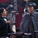 There is a power struggle between Madame Zou and the military