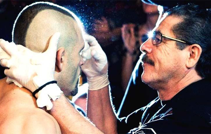 Stitch checks over Chuck Liddell between rounds
