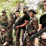 Michael Jai White preps for the explosive opening of Triple Threat alongside co-stars