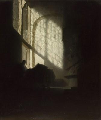 Volger van Rembrandt - Lezende man in een donkere kamer