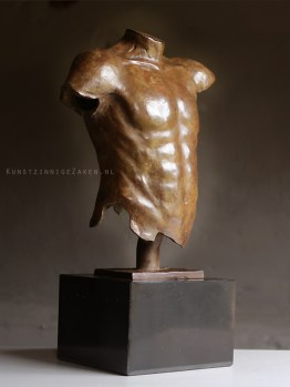male torso sculpture in bronze