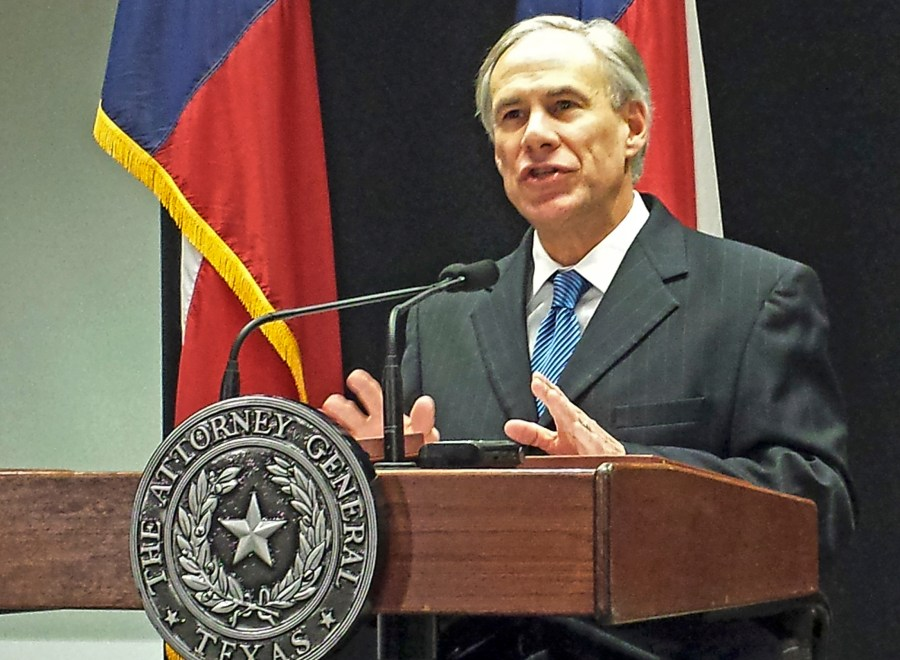 Texas Attorney General Greg Abbott speaks at a news conference in Austin, Texas, about a lawsuit challenging the president's use of an executive order to ease the threat of deportation for some undocumented immigrants, December 3, 2014.