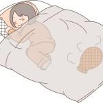 湯たんぽの布団で寝る女性