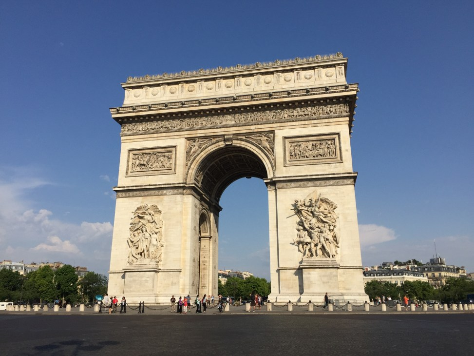 Admiring the magnificent Arc de Triomphe in Paris, France.