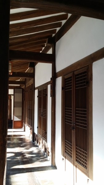 Hallway with windows by the side of a hanok, a traditional Korean house in Seoul, Korea.