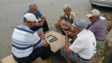 Playing a game of dominoes by the road in Tirana, Albania.