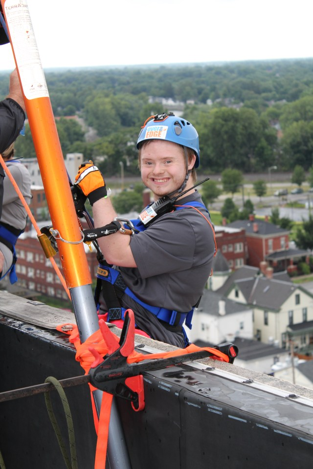 client with down syndrome rappelling over the edge of the lamplight inn of fort wayne