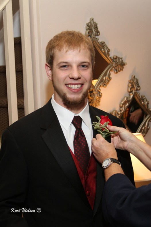 Red Rose Boutonnieres for groomsmen