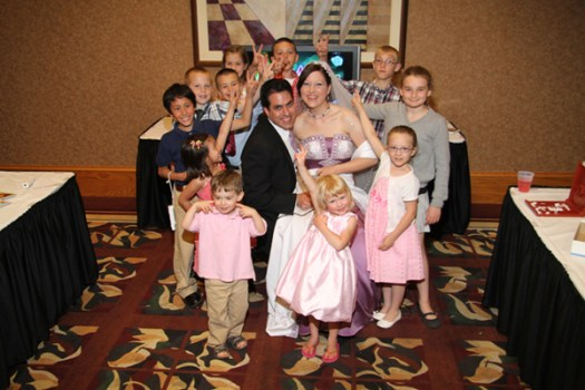 photos of bride and groom with children