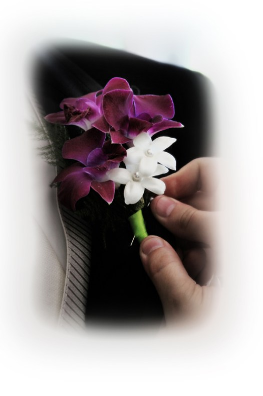 purple and white boutonnieres