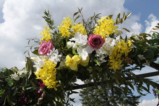 flowers decorating wedding arch