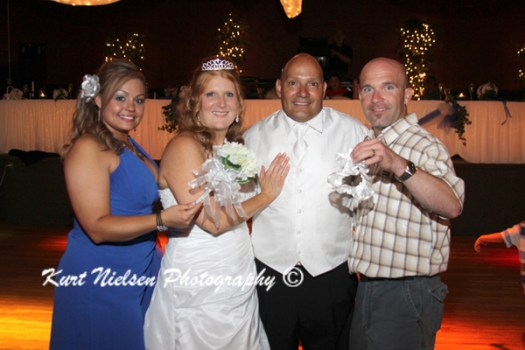 pictures of the bride and groom with the garter and bouquet catchers