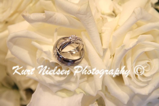 wedding rings on white roses