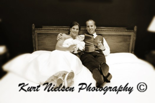 picture of the bride and groom in bed