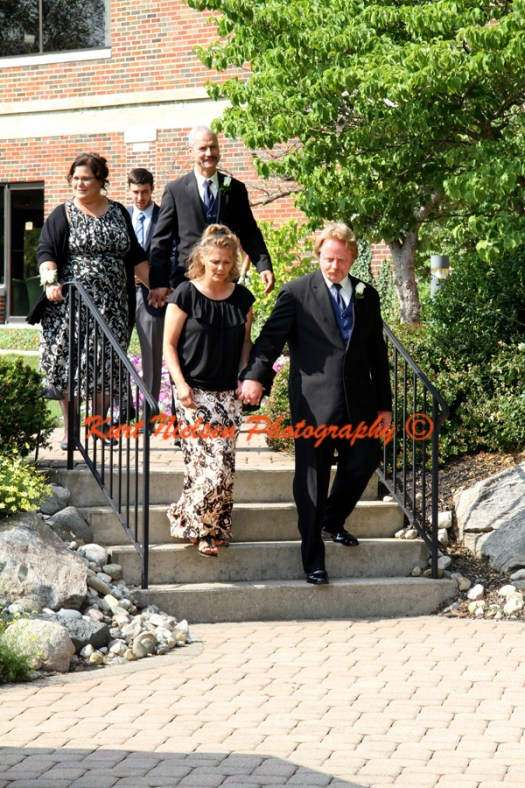 parents entering wedding site