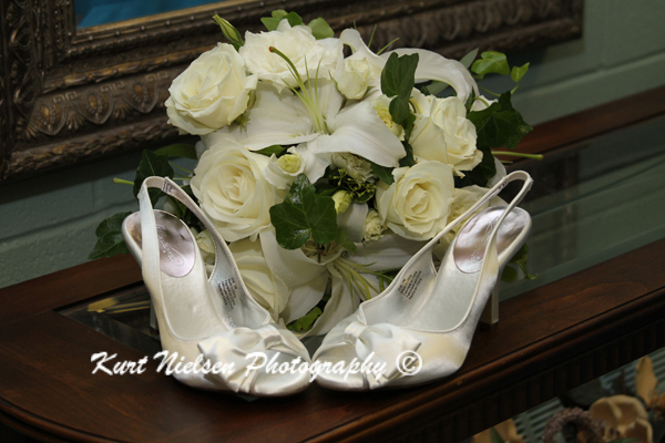 white roses wedding bouquet and shoes