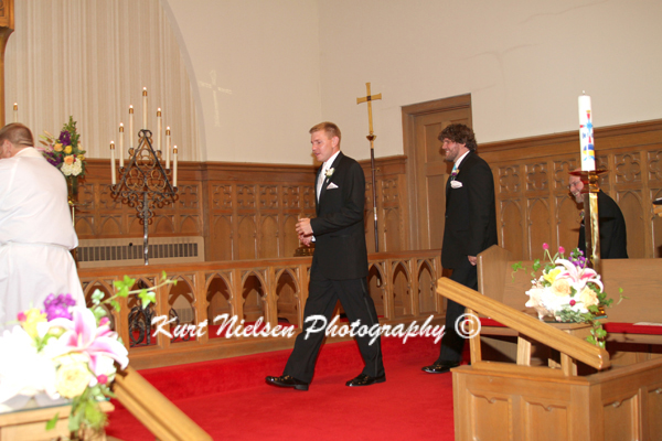 groom entering the church
