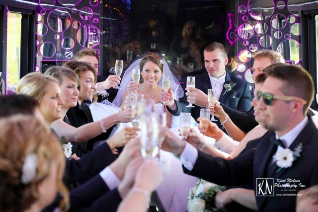 champagne toast in back of limo as captured by Kurt Nielsen Photography