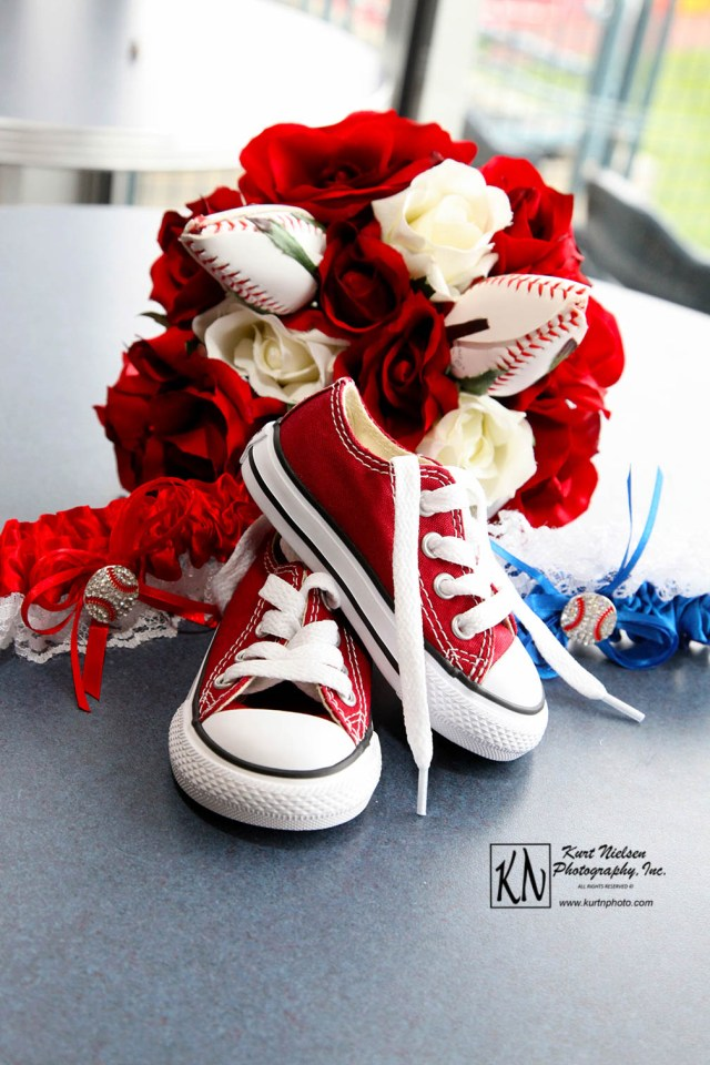 red converse wedding shoes with artificial rose and baseball roses bouquet