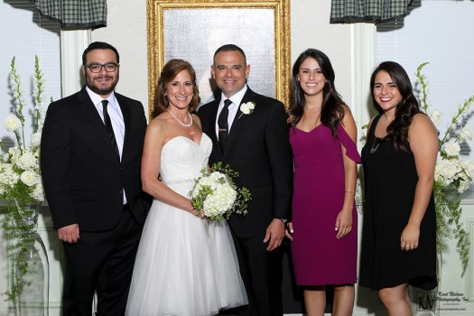 the bride and groom with the groom's son and daughters