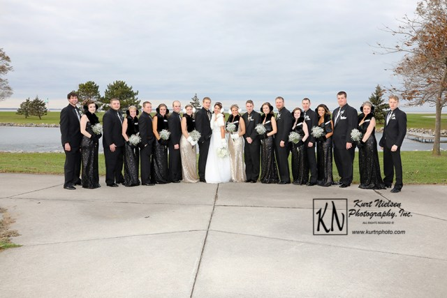 winter wedding party photo on the beach of lake erie