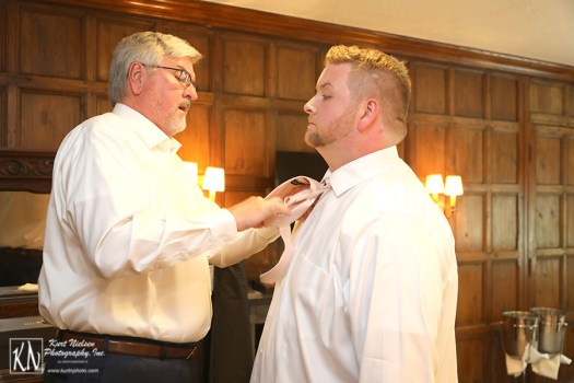 getting the groom ready for the wedding