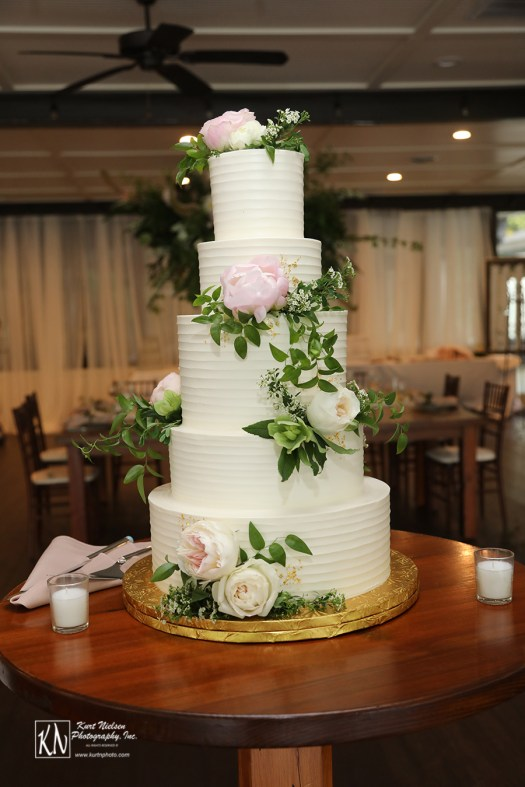 gold flakes on a garden-inspired 5 tiered wedding cake from Luna Bakery