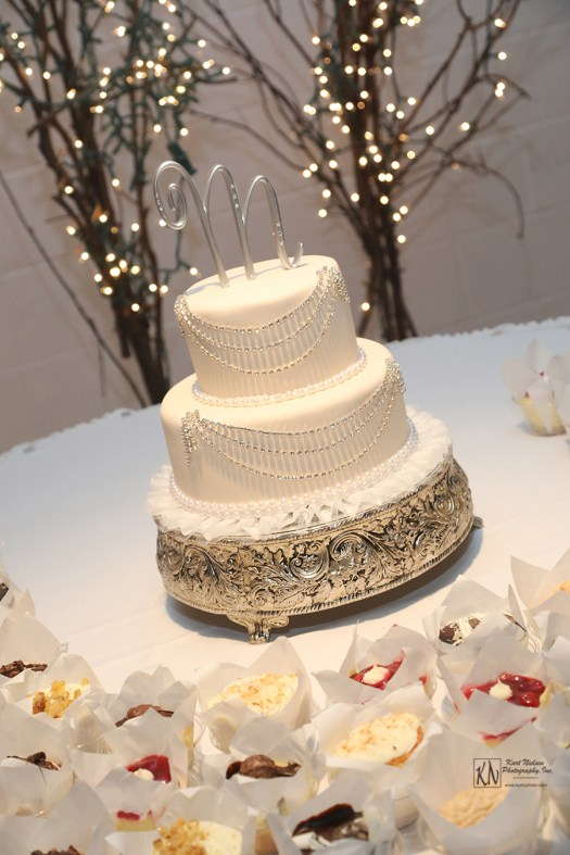 2 tier fondant covered wedding cake with scalloped silver bead garland from Michael's Cafe and Bakery