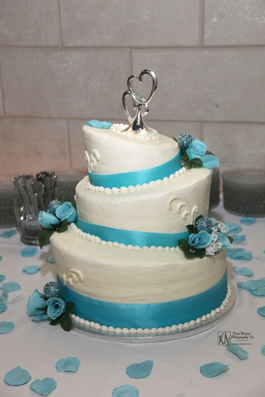caribbean blue flowers on tilted wedding cake