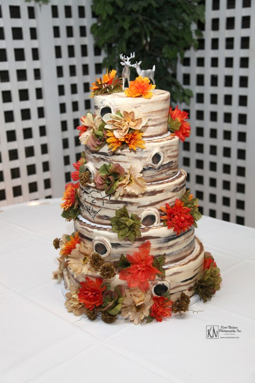wood log themed five tier wedding cake with deer cake topper