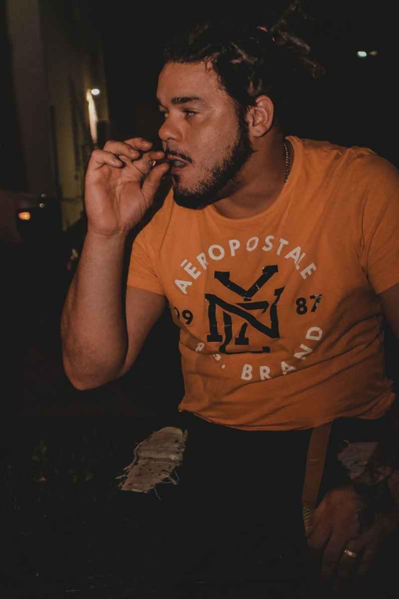 photo of man smoking blunt