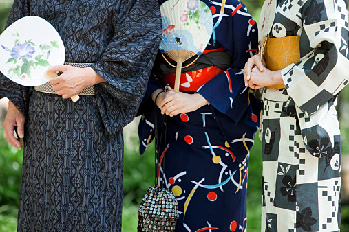 Midsection of family wearing a Yukata