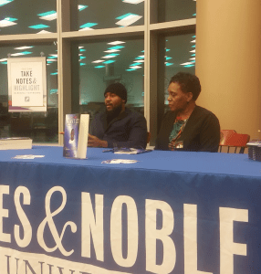 """Obidi Anamdi, left, sits with the mother of Sean Bell at the Barnes & Noble bookstore at Kean for a signing of her book, """"Just 23: Thoughts From a Mother."""" Credit: Rebecca Panico"""