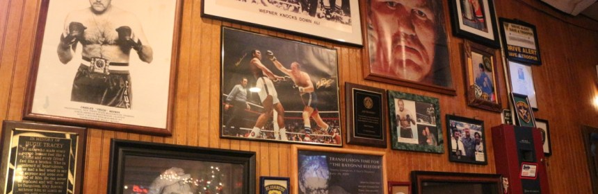"A wall devoted to mementos of Chuck Wepner. The owner of the bar, Joe Sharkey, calls this the ""Wall of Fame."" Credit: Rebecca Panico"