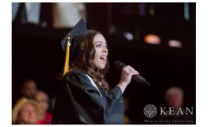 A previous winner singing the national anthem at the commencement ceremony. Photo Courtesy of Kean University.