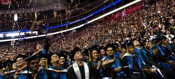 Kean students celebrating at the 2016 graduation. Photo Courtesy of Kean University.