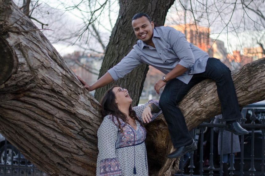 Paige Bollman and Martin Alonso share laughs as they pose for their engagement photos. Credit: AD Photography
