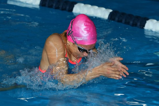 Kean swimmer dives in the pool looking to win her race. Photo by Larry Levanti