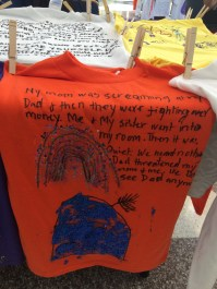 T-shirts created by children of domestic violence.
