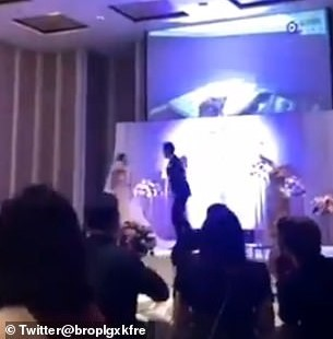 Trending footage shows the couple walking down the aisle and then standing on a stage at their wedding banquet. Then the groom allegedly humiliated his partner with a sex tape