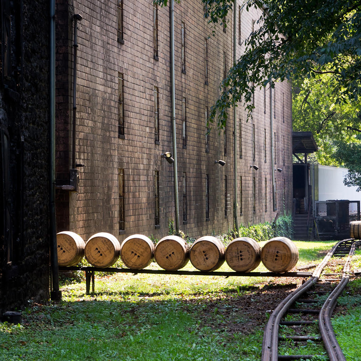 barrels in a line waiting by train tracks