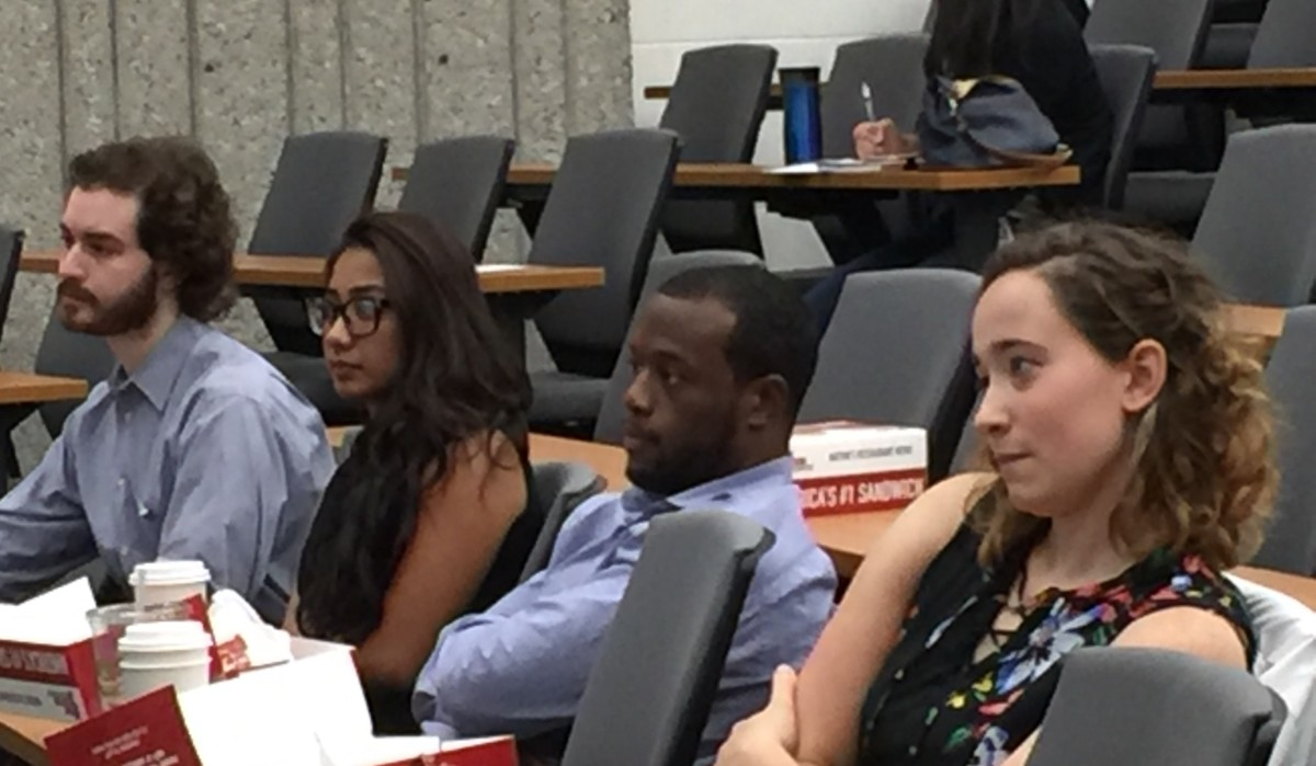 Medical students listening to Dr. Margaret Flowers. At the right is Sarah Parker, one of the leaders of SNaHP.