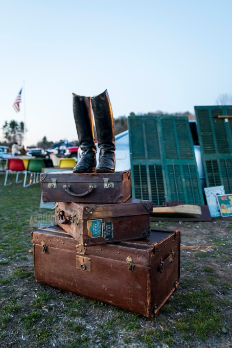 A lone pair of boots stand atop a trio of trunks at the Elephant's Trunk Flea market. Unusual sights such as this are common at the weekly flea market.