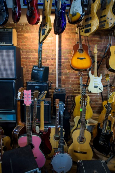 Guitars, guitar amps, and a banjo at the Music Guild in Danbury, Conn. on Oct. 14, 2016.