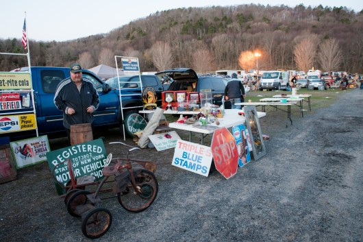 Having finished setting up his wares for display, Rags Rosenberg of Montgomery, NY waits for the crowds of people to take a look and make a sale. Rags is an experienced Elephant's Trunk vendor, having attended these flea markets for over 18 years.