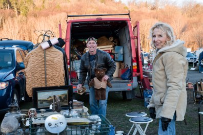 Chuck Haegele of Hammacroix NY andKim Dolent of Steventown NY continue to unload their wares as the sun rises on the field at Elephant's Trunk in New Milford, CT.