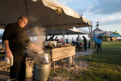 Chris Tuturro, Chef at Ripkas At the Beach checks on the boiling lobsters as the sun descends on Sheffield Island in Norwalk, Conn. on June 30, 2016.