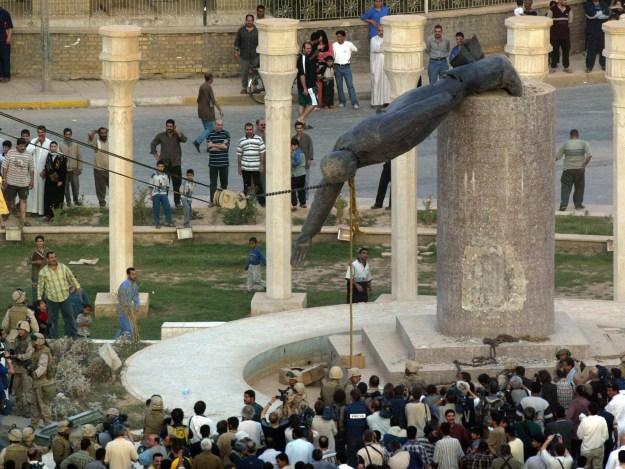 Saddam Hussein's statue hauled down in Baghdad as his regime collapses, April 9, 2003